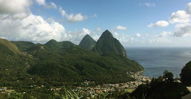 The two peaks of the Pitons are represented on the flag of Saint Lucia